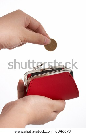 A hand dropping a coin inside a red purse