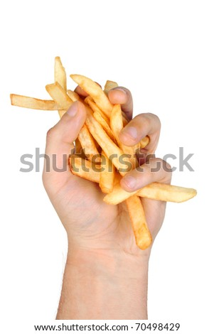 A Hand Full of French Fries Isolated on a White Background