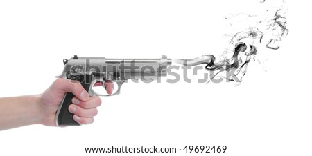 A hand gripping a pistol grip hand gun isolated on white background with black smoke with copyspace with room for your text - stock photo