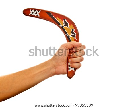 a hand holding a boomerang, the ancient aborigin hunting tool from Australia - stock photo