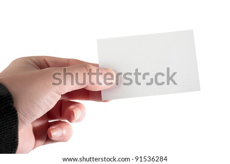 a hand holding a business card