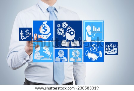 A hand holding a business investment scheme.  - stock photo