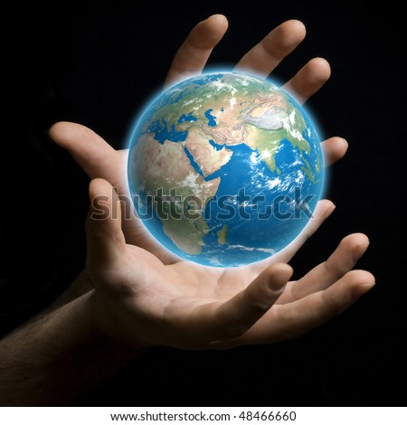 A hand holding a globe, saving environment recycle