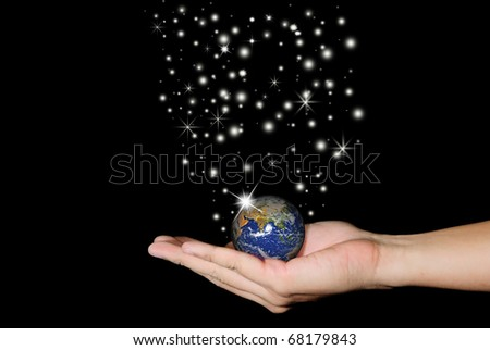 A hand holding a globe, saving environment recycle.