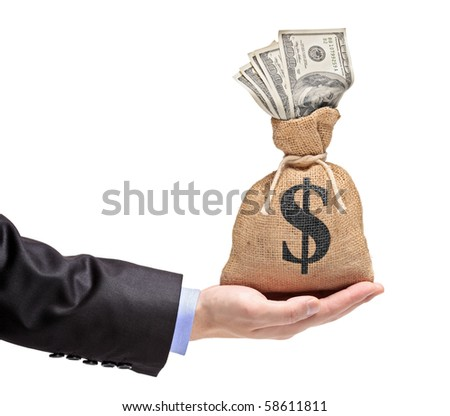 A hand holding a money bag with US dollar isolated against white background - stock photo