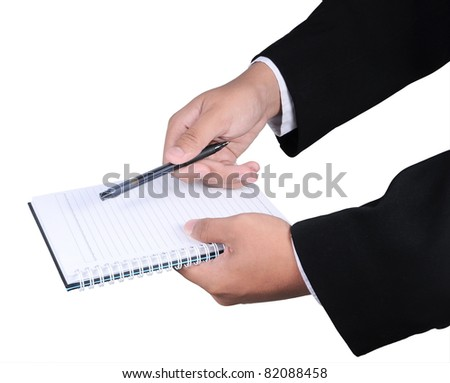 A hand holding a pen above a blank page of a spiral notebook isolated on white background - stock photo