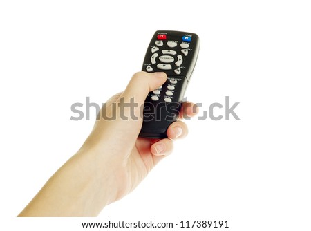 A hand holding a remote control isolated over a white background - stock photo