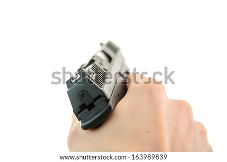 A hand holding a semi automatic handgun - stock photo