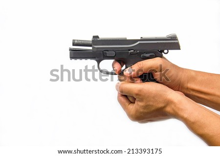 A hand holding a semi automatic handgun that is in ready  - stock photo