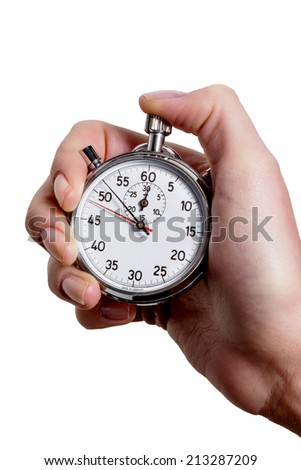 a hand holding a stopwatch. - stock photo