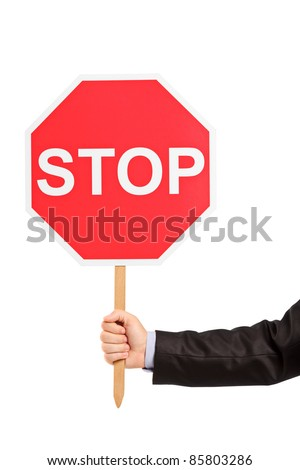 A hand holding a traffic sign stop isolated against white background - stock photo