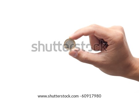 A hand holding an euro coin - stock photo