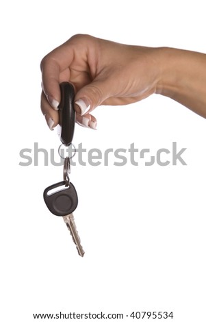 A hand  holding car keys and handing them off.
