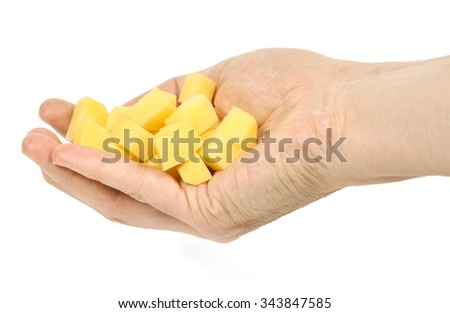 A hand holding diced potato isolated on white background