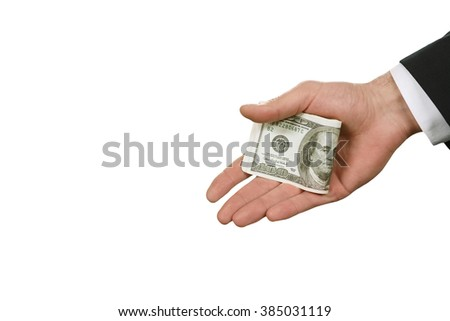 A hand holding money. A serious criminal. Origin of crime. Easy way to solve problems. - stock photo