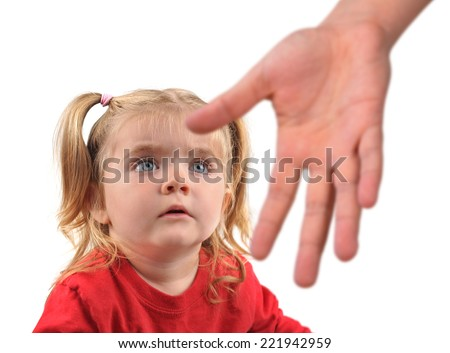 A hand is reaching down to a scared little child on a white isolated background for a helping or stranger concept. - stock photo