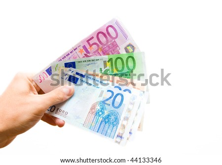 A hand lending banknotes, isolated on white
