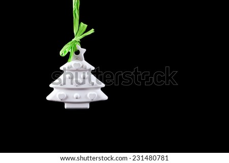 A hand made plaster christmas tree decorated with a star and hearts ornament. - stock photo
