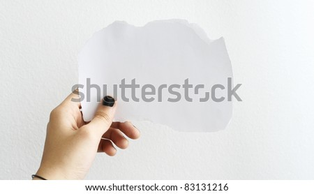 A hand of a casual person, holding a white blank paper, isolated on white background. - stock photo