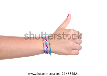 a hand of a young woman makes a sign on white background