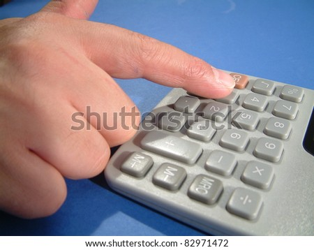 a hand of man pressing button in computer