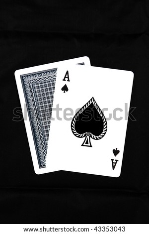 A Hand of Playing Card displaying an Ace - stock photo