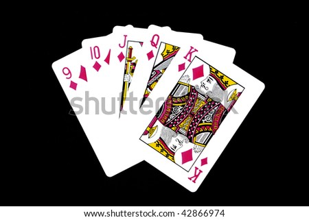A Hand of Playing Card Displaying Straight Flush - stock photo