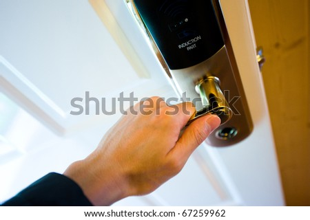 A hand opening the electronic lock. - stock photo