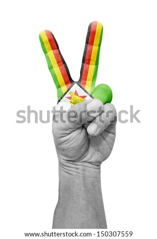 A hand painted with a Zimbabwe flag making a V for victory symbol, isolated against white.  - stock photo