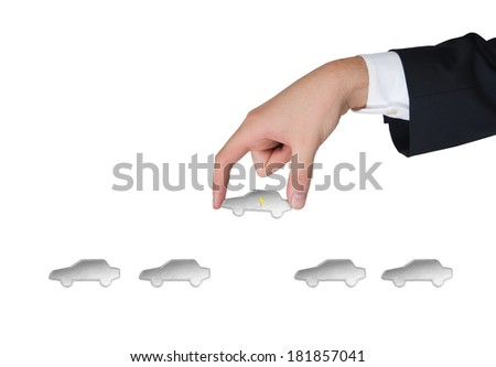 A hand picks up a car 3 - stock photo