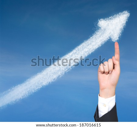A hand pointing out the arrow - stock photo