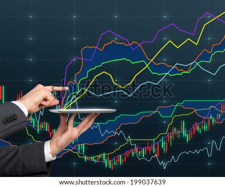 A hand pointing out the graph.  - stock photo