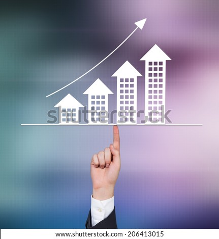 A hand pointing out the real estate chart. Abstract background.  - stock photo