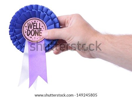 a hand presenting a well done badge isolated on white - stock photo