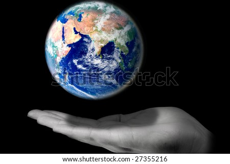 A hand protecting the world from falling down. ( A good environmental concept)