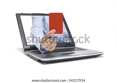 a hand reaches out of a laptop and shows a red card - stock photo