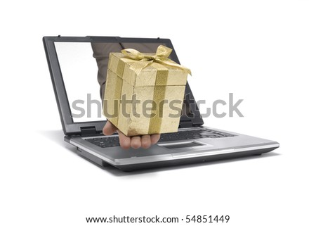 A Hand reaches out of an Laptop with a gift - stock photo
