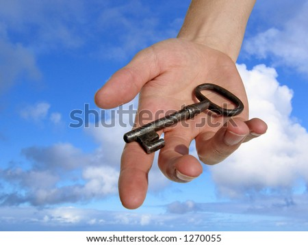 A hand reaching down from the sky, handing you a key. (Clipping path included) - stock photo