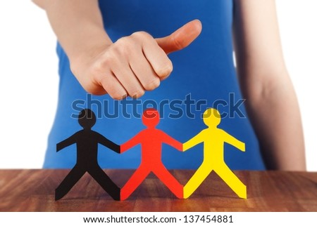 a hand shows thumbs up next to a colorful paper chain family, isolated - stock photo