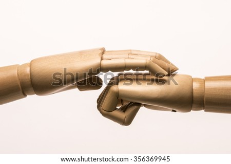 A hand soothes a closed fist. White background - stock photo