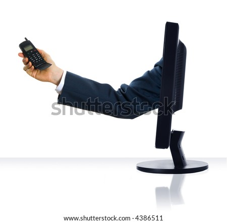 A hand sticking from a monitor with a cell phone