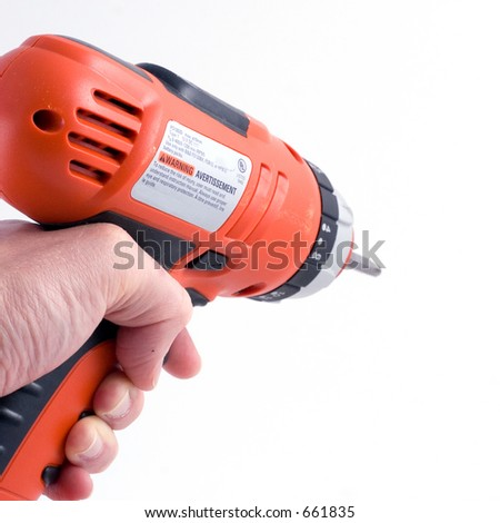 a hand using a drill (part of a set) - stock photo