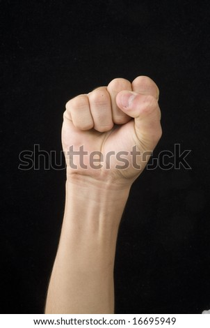 A hand whit victory signal in a black back - stock photo