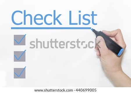 A hand with a marker writing 'Check List'. - stock photo