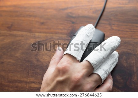 a  hand with PC mouse, concept incapacitated, handicap - stock photo