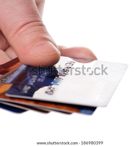 A hand with unreadable credit plastic card - stock photo
