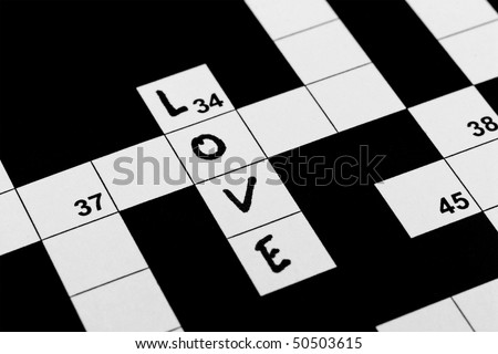 A hand written word love in a crossword puzzle - stock photo