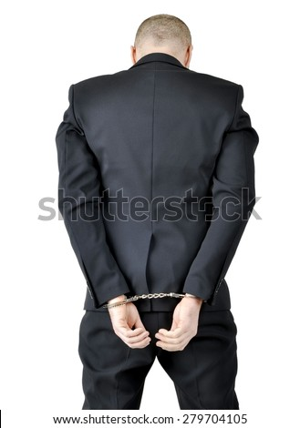 A handcuffed businessman Boss look down, isolated on white background. View from behind  - stock photo