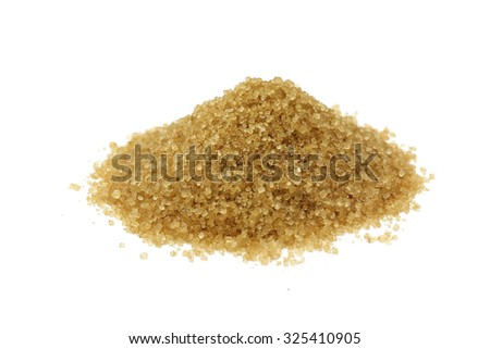 a handful of brown cane sugar on a white background
