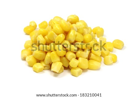 a handful of canned corn on a white background